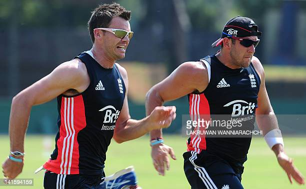 England's James Anderson and Tim Bresnan warm up during a practice session at the Sinhalese Sports Club Ground in Colombo on March 19 2012 England...