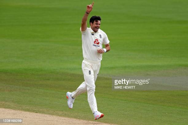 England's James Anderson celebrates after taking the wicket of Pakistan's Asad Shafiq on the third day of the third Test cricket match between...