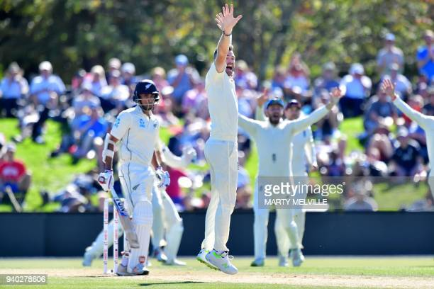 England's James Anderson celebrates New Zealand's Jeet Raval being caught during day two of the second cricket Test match between New Zealand and...
