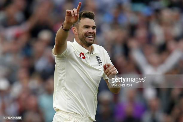 England's James Anderson celebrates taking the wicket of India's Ajinkya Rahane for 0 runs during play on the second day of the fifth Test cricket...