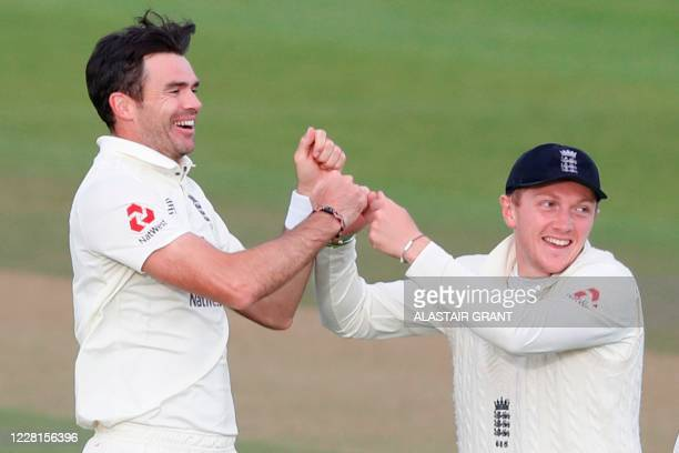 England's James Anderson celebrates with England's Dom Bess after taking the wicket of Pakistan's Abid Ali on the second day of the third Test...