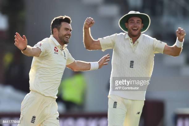 England's James Anderson celebrates with England's Stuart Broad after taking his 500th Test match wicket after taking the wicket of West Indies'...