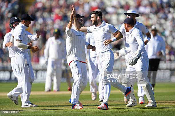 England's James Anderson celebrates with teammates after taking the wicket of Pakistan's Yasir Shah during play on the final day of the third test...