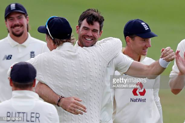 England's James Anderson embraces England's Joe Root who takes the catch of Pakistan's Azhar Ali to get Anderson his 600th test match wicket, on the...
