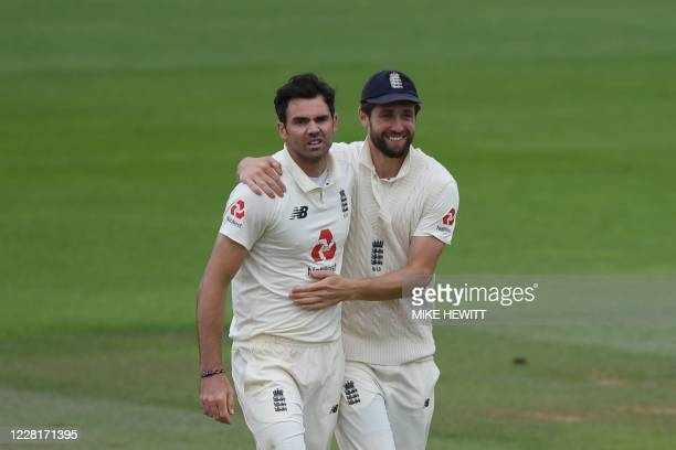 England's James Anderson is congratulated by England's Chris Woakes after taking the wicket of Pakistan's Naseem Shah to end the Pakistan first...