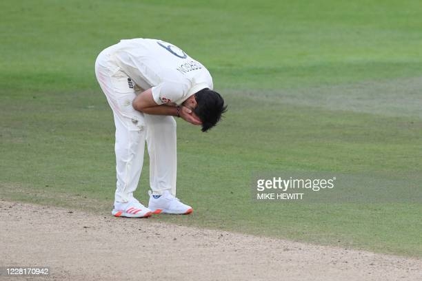 England's James Anderson reacts after a chance to catch was dropped in the field off his bowling on the third day of the third Test cricket match...