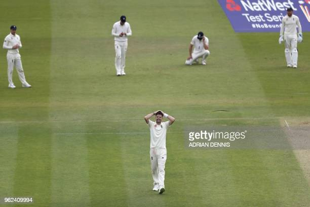 England's James Anderson reacts after England's Mark Wood drops a catch off the batting of Pakistan's Shadab Khan on the second day of the first...
