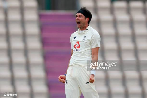 England's James Anderson reacts after taking the wicket of West Indies' John Campbell lbw on the second day of the first Test cricket match between...