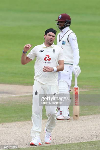 England's James Anderson reacts to a dropped catch on the second day of the third Test cricket match between England and the West Indies at Old...