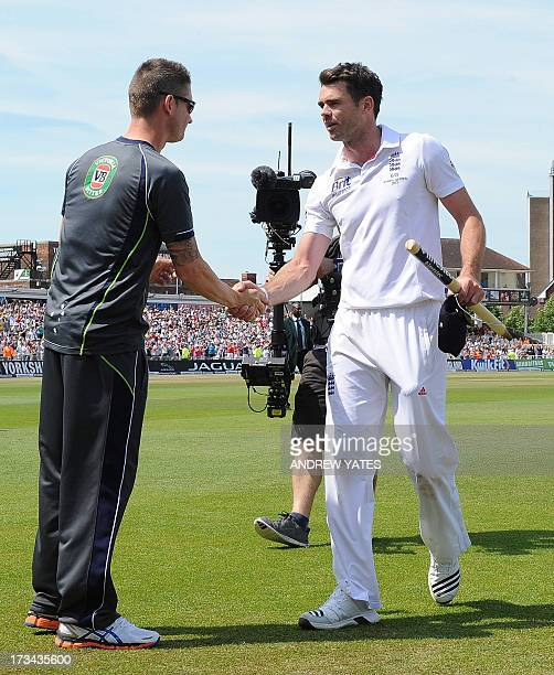 England's James Anderson shakes hands with Australia's captain Michael Clarke after England's narrow victory over Australia on the fifth day of the...