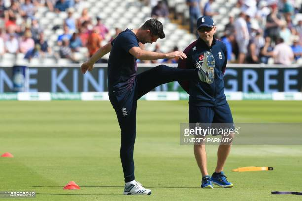 England's James Anderson stretches before play on the second day of the first Ashes cricket Test match between England and Australia at Edgbaston in...