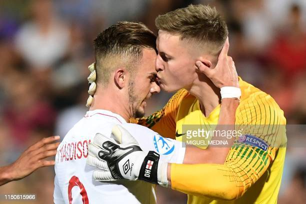 England's James Maddison embraces England's goalkeeper Dean Henderson after he made a save during the Group C match of the U21 European Football...