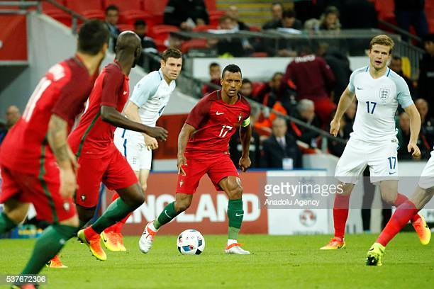 England's James Milner vies with Portugal's Nani during an international friendlies match between England and Portugal at Wembley Stadium on June 2...