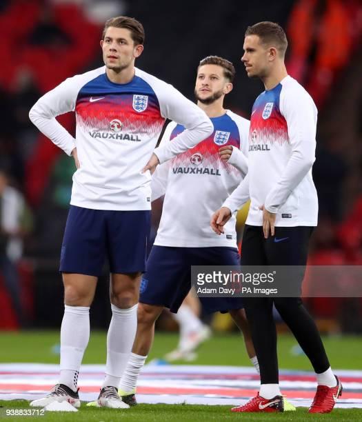 England's James Tarkowski Adam Lallana and Jordan Henderson warm up before the international friendly match at Wembley Stadium London