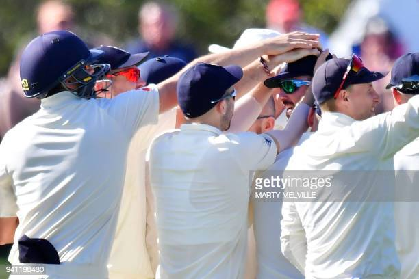 England's James Vinc celebrates New Zealand's Tom Latham being caught with teammates during day five of the second cricket Test match between New...