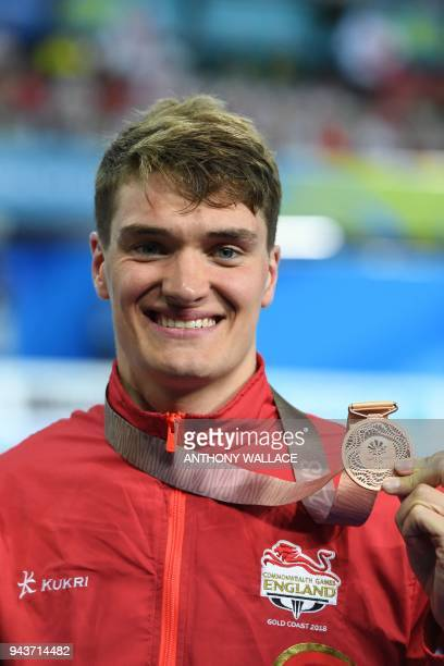 England's James Wilby poses with his bronze medal after the swimming men's 50m breaststroke final during the 2018 Gold Coast Commonwealth Games at...