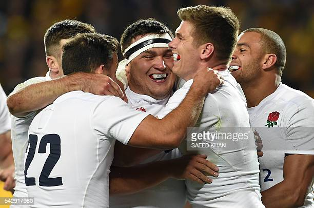 England's Jamie George celebrates a successful try against Australia with teammates during their third and final rugby union Test match in Sydney on...