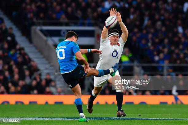TOPSHOT England's Jamie George tries to block a kick by Italy's flyhalf Tommaso Allan during the Six Nations international rugby union match between...