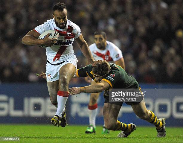 England's Jamie JonesBuchanan evades a tackle from Australia's Chris Lawrence during the Four Nations Final rugby league Test match between England...