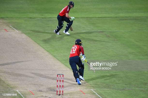 England's Jason Roy and England's Jos Buttler run between the wickets during the third T20 international cricket match between South Africa and...