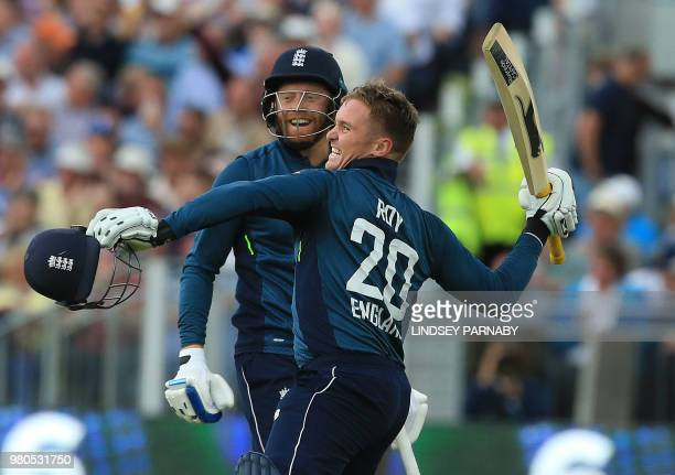 England's Jason Roy celebrates his century with England's Jonny Bairstow during the fourth One Day International cricket match between England and...