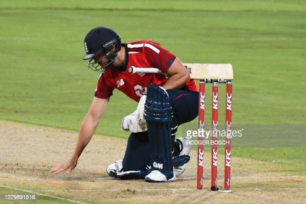 England's Jason Roy checks the pitch during the third T20 international cricket match between South Africa and England at Newlands stadium in Cape...