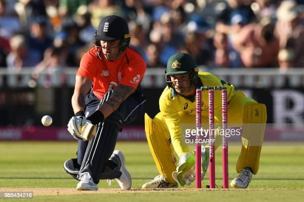England's Jason Roy plays a shot as Australia's Alex Carey keeps wicket during the Twenty20 International cricket match between England and Australia...