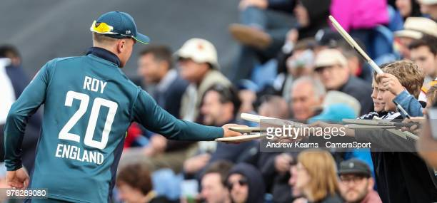 England's Jason Roy signs souvenir cricket bats for young supporters during the Royal London OneDay Series 2nd ODI between England and Australia at...