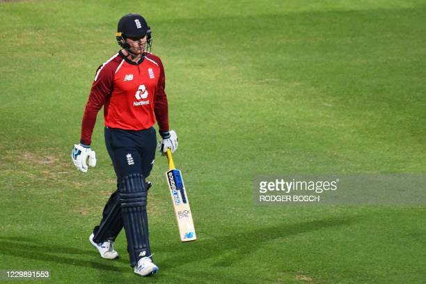 England's Jason Roy walks back to the pavilion after his dismissal by South Africa's Anrich Nortje during the third T20 international cricket match...