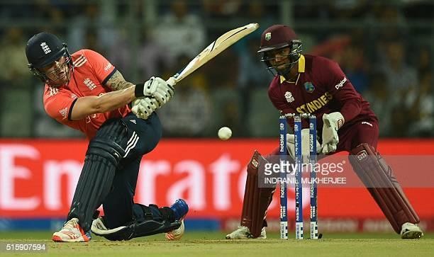England's Jason Royis watched by West Indies's wicketkeeper Denesh Ramdin as he plays a shot during the World T20 match between West Indies and...