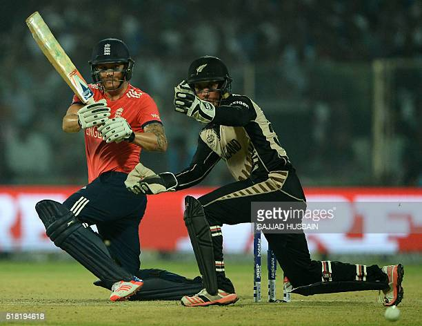 England's Jason Royplays a shot past New Zealand's wicketkeeper Luke Ronchi during the World T20 cricket tournament semifinal match between England...