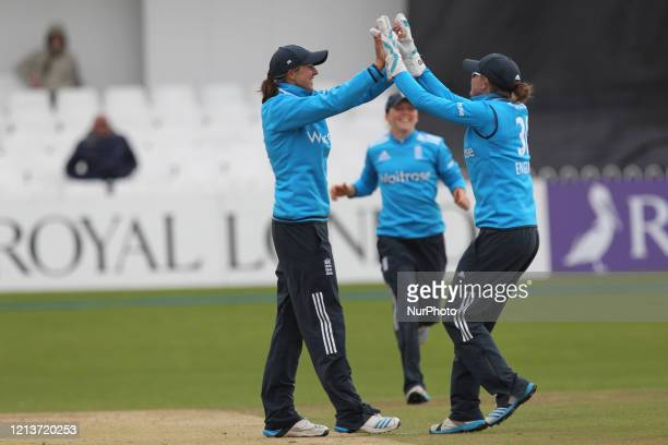 England's Jenny Gunn and Sarah Taylor celebrate a wicket during the First One Day International between England Women and India Women at Scarborough...