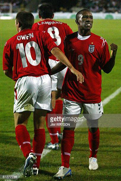 England's Jermain Defoe gestures as he celebrates scoring against Poland 08 September 2004 in Chorzow Poland during their World Cup football...