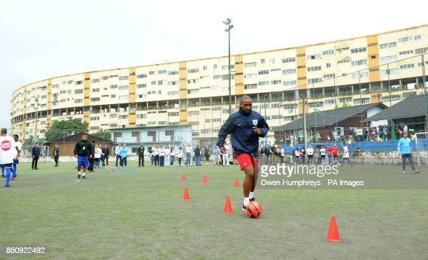 England's Jermain Defoe meets children from a Sport Relief funded project in Bola Pra Frente Rio de Janeiro Brazil
