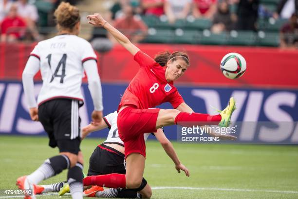 England's Jill Scott kicks the ball just in front of Germany's goal during the bronze medal match at the FIFA Women's World Cup in Edmonton Canada on...