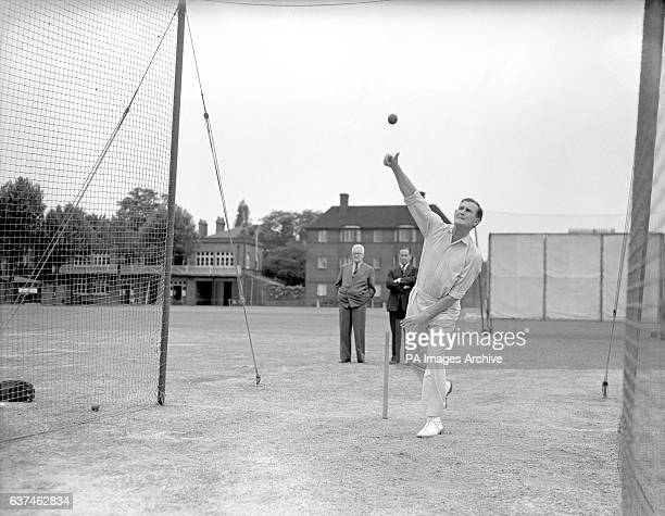 England's Jim Laker bowling in the nets in a vain bid to prove his fitness for the second test as MCC assistant secretary SC Griffith looks on