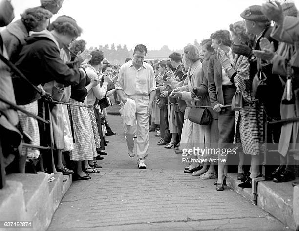 England's Jim Laker is applauded off the field after taking six second innings wickets to help England to victory