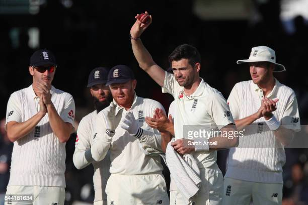 England's Jimmy Anderson shows the ball to spectators in celebration of his 500th Test wicket during day two of the 3rd Investec Test match between...