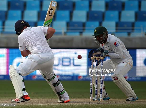 England's Joe Bell plays a shot as Pakistan's wicket keeper Safraz Ahmed tries to catch the ball during the fourth day of the second Test cricket...