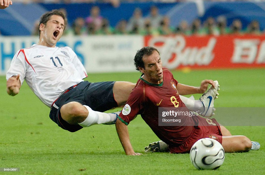 England`s Joe Cole, left, is fouled by Petit from Portugal d : News Photo