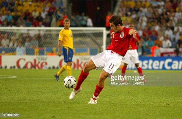 England's Joe Cole scores the opening goal of the game