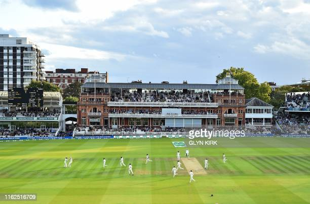 England's Joe Denly celebrates with England's Stuart Broad after catching the ball to take the wicket Australia's captain Tim Paine for four runs...