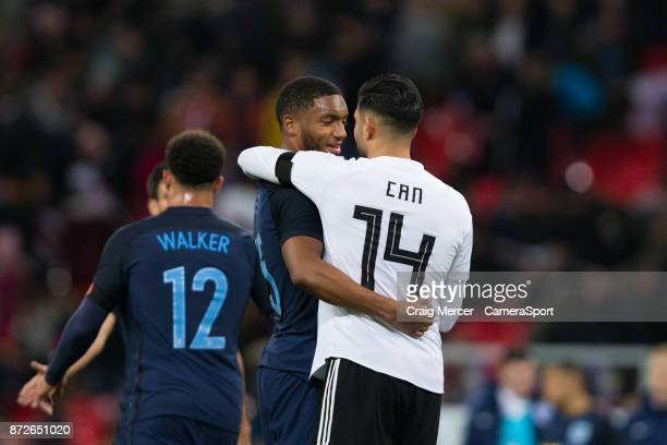 England's Joe Gomez is embraced by Germanys Emre Can at full time of the International Football Friendly match between England and Germany at Wembley...