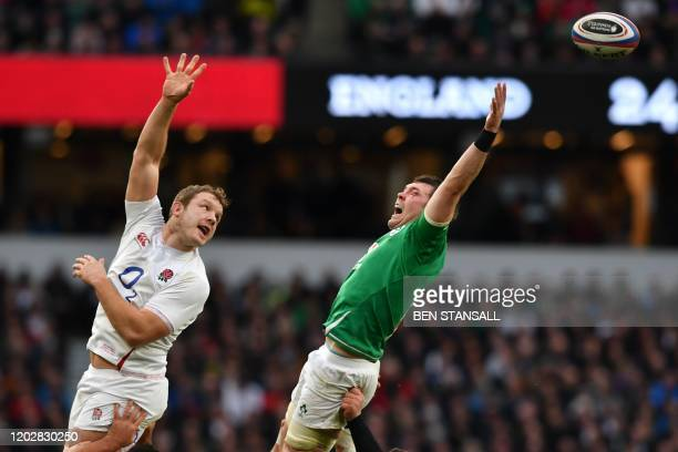 TOPSHOT England's Joe Launchbury and Ireland's flanker Peter O'Mahony jumps for the vall in the lineout during the Six Nations international rugby...