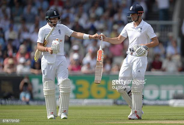 England's Joe Root and captain Alastair Cook congratulate each other on the first day of the second cricket test match between England and Pakistan...