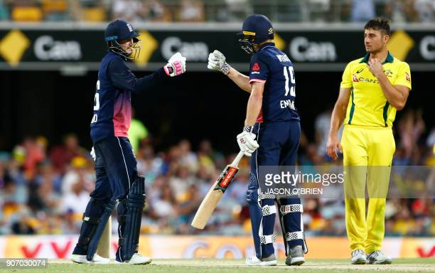 England's Joe Root and Chris Woakes celebrate the team's victory as Australia's Marcus Stoinis looks on during the oneday international cricket match...
