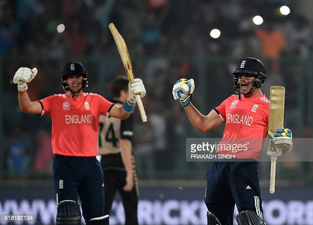 England's Joe Root and Jos Buttler celebrate after winning the World T20 cricket tournament semifinal match between England and New Zealand at the...