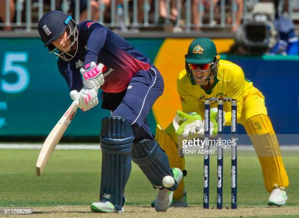 England's Joe Root bats watched by Australia's wicketkeeper Tim Paine during the fifth oneday international cricket match between England and...