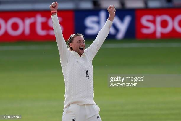 England's Joe Root celebrates after taking the wicket of Pakistan's Asad Shafiq on the fifth day of the third Test cricket match between England and...