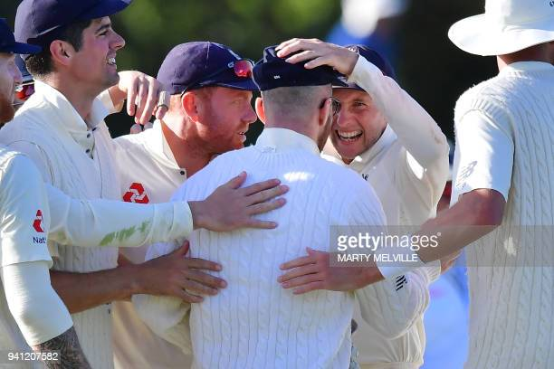 England's Joe Root celebrates New Zealand's Colin de Grandhomme being caught with teammate Jack Leach during day five of the second cricket Test...